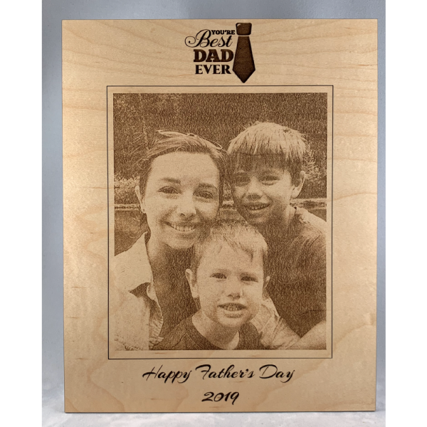 laser engraved wood photo of mom and sons that says happy father's day