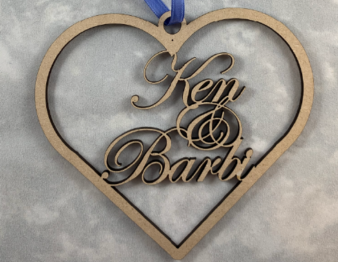laser engraved heart ornament with names inside